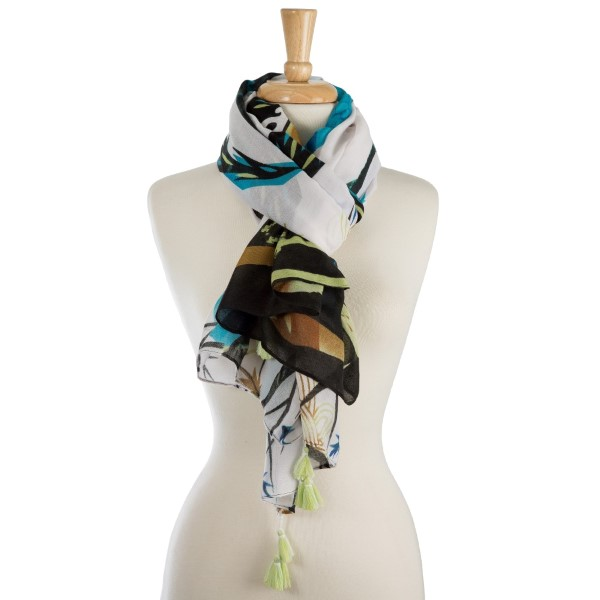 "Lightweight, peacock printed scarf with tassel accents. 100% polyester. Measures 36"" x 72"" in size."