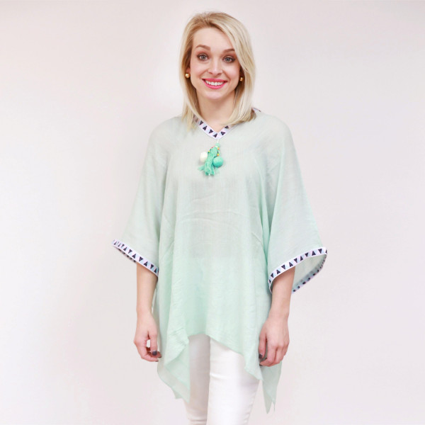 Lightweight poncho top with an aztec print and a tassel focal. This can also be worn as a swimsuit coverup. 100% viscose. One size fits most.