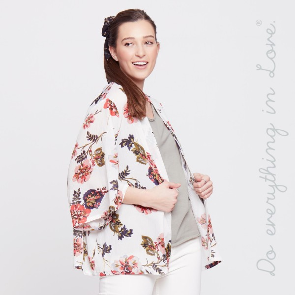 Lightweight, short sleeve kimono with a floral print. 100% polyester. One size fits most.