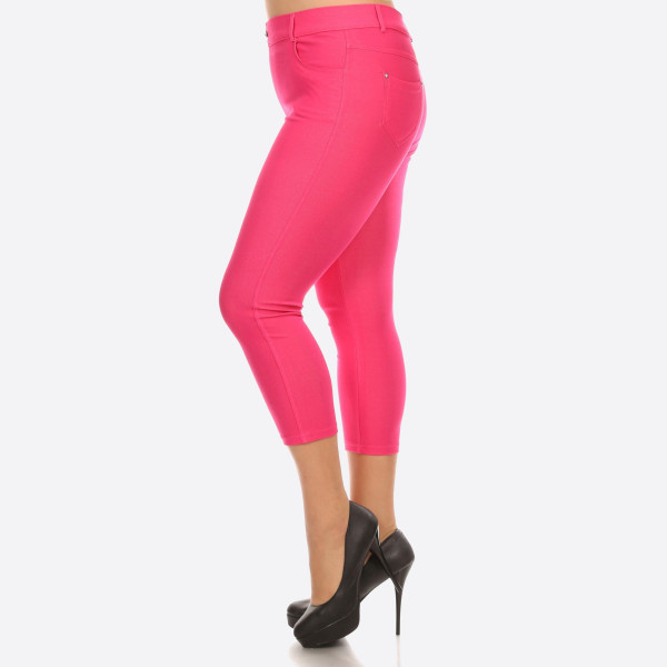 The Original, plus size is your standard 5 pocket jean capri jegging. With classic silhouette construction, the Original is smooth, stretchy, and fits like a glove. There are also rhinestone pocketing and button embellishment highlighting the look and feel.   • Capri jeggings featuring a light sheen and jean-style construction  • Lightweight, breathable cotton-blend material for all day comfort  • Belt loops with 5 functional pockets  • Decorative, non-functional rhinestone button and fly with rivet details  • Super Stretchy  • Pull up Style   Composition: 68% Cotton, 27% Polyester, 5% Spandex.   Pack Breakdown: 6pcs/pack. 2-XL: 2-XXL: 2-XXXL
