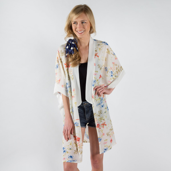 Lightweight, short sleeve kimono with floral print. 100% polyester. One size fits most.
