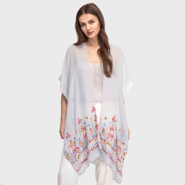 Lightweight, short sleeve kimono with embroidery and a rhinestone detail. 35% viscose and 65% polyester. One size fits most.