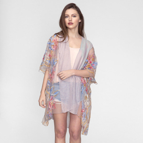 Lightweight, short sleeve kimono with floral embroidery and a mesh trim. 35% viscose 65% polyester. One size fits most.