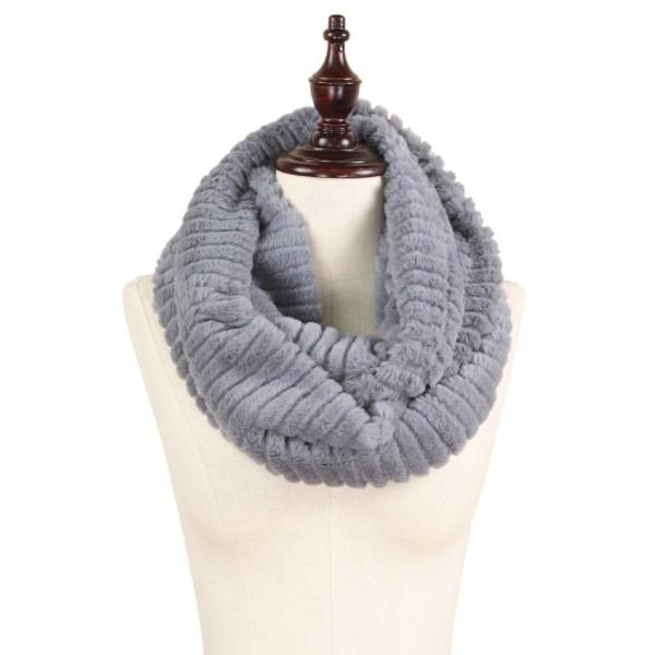 """Stripe faux fur infinity scarf. 100% polyester. Size: 7.5""""W x 31.5""""L"""