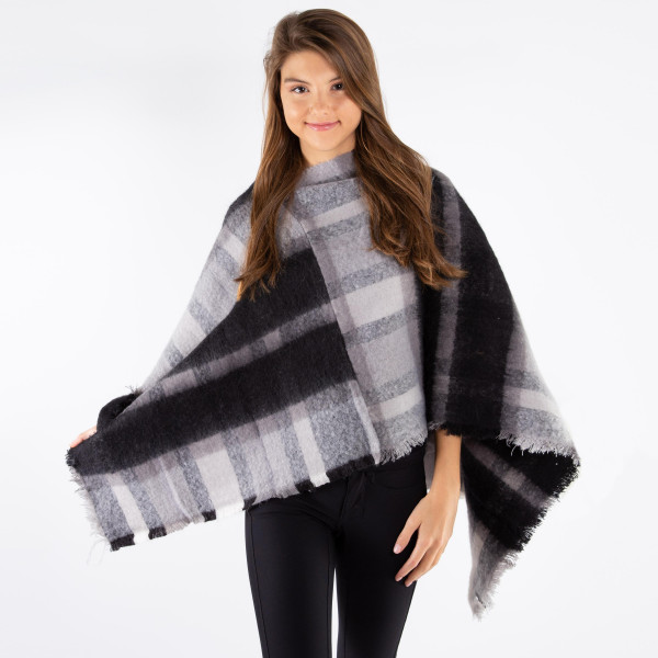 Soft touch plaid poncho. 100% acrylic.   One size fits most.
