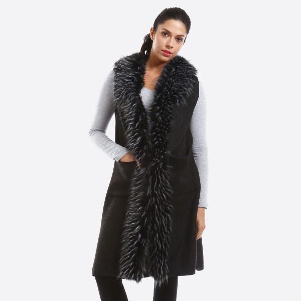 Long line vest with faux fur trim. 100% acrylic.   One size fits most.