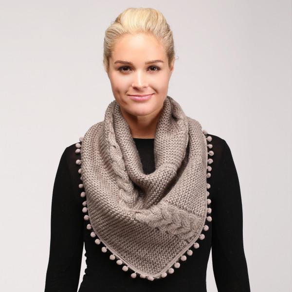 Cable knit infinity scarf with pom pom trim. 100% acrylic.