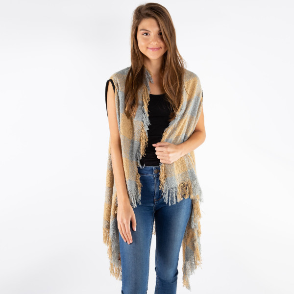 Soft touch buffalo check vest with fringes.  - One size fits most 0-14 - 100% Acrylic