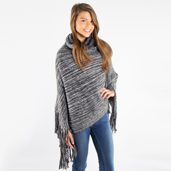 Brushed knit poncho. 100% acrylic. One size fits most.