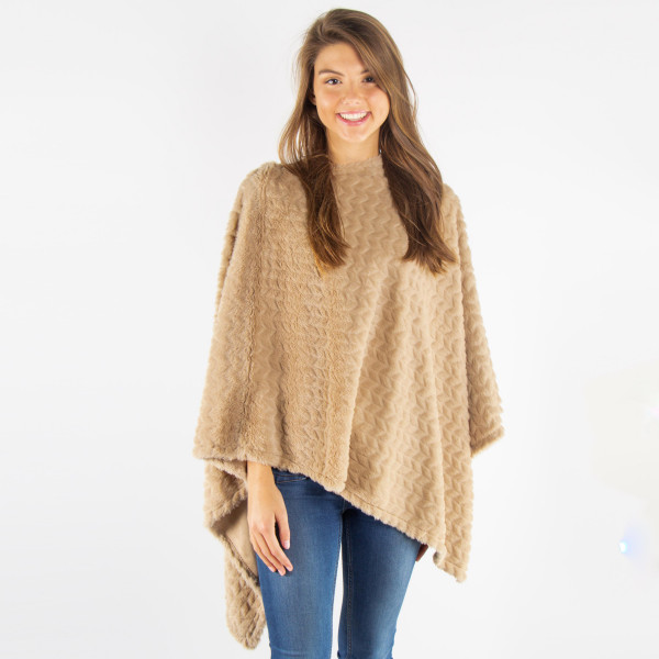 Texture faux fur poncho. 100% polyester. One size fits most.