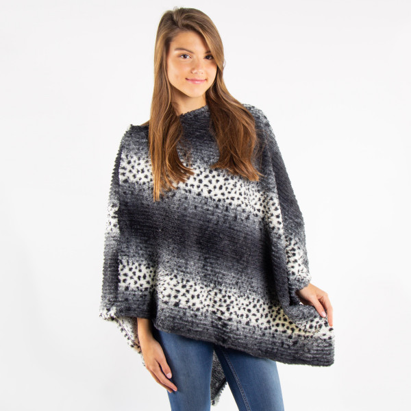 Leopard faux fur poncho. 100% polyester. One size fits most.