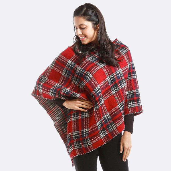 """Plaid print poncho with frayed edges.  - One size fits most 0-14 - Approximately 36"""" in length  - 100% Acrylic"""