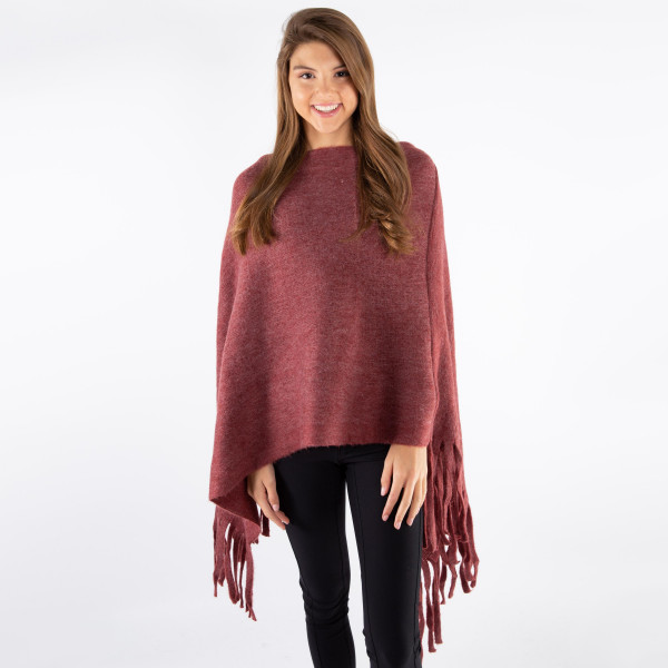 Solid color poncho with fringe. 100% acrylic.   One size fits most.