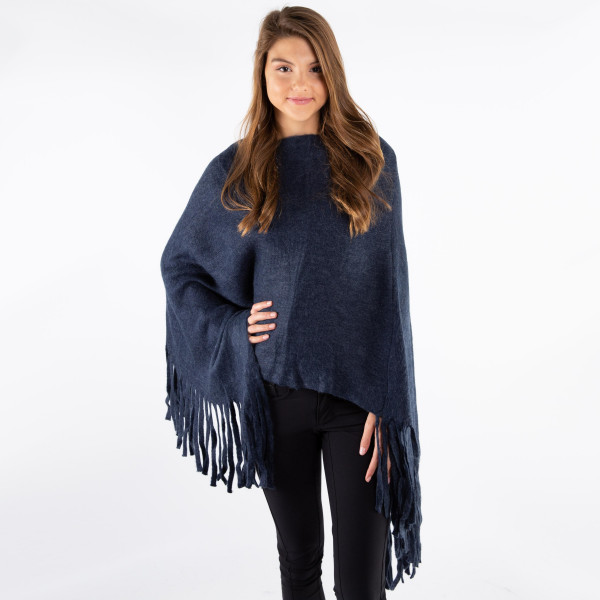 Solid color poncho with fringe.  - One size fits most 0-14 - 100% Acrylic