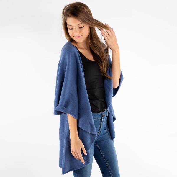 Knit vest with cape detail. 100% acrylic.