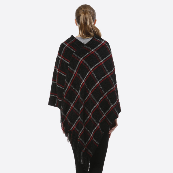 Chenille plaid poncho with fringe. 100% polyester.   One size fits most.