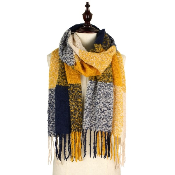 Soft knit check scarf with fringe. 100% acrylic.
