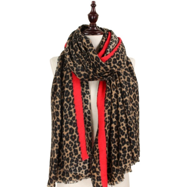Lightweight leopard print scarf with red accent. 100% acrylic.