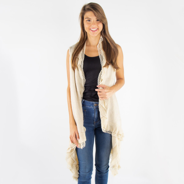 Ruffle knit vest. 100% acrylic. One size fits most.