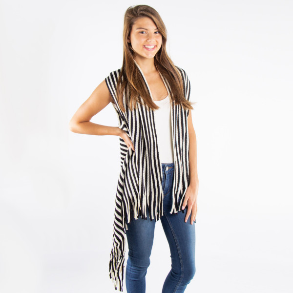 Stripe knit vest with fringes.  - One size fits most 0-14  - 100% Acrylic