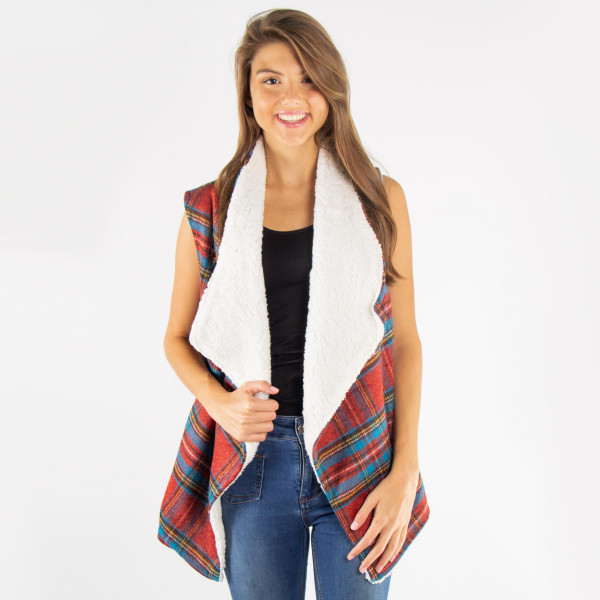 Plaid vest with faux sherpa lining. 100% polyester.   One size fits most.