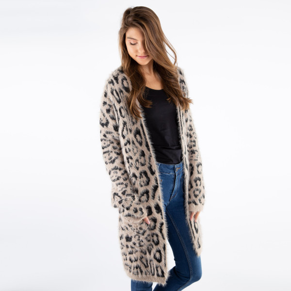 Leopard print mohair cardigan. 40% acrylic, 30% polyester, and 30% polyamide.   One size fits most.