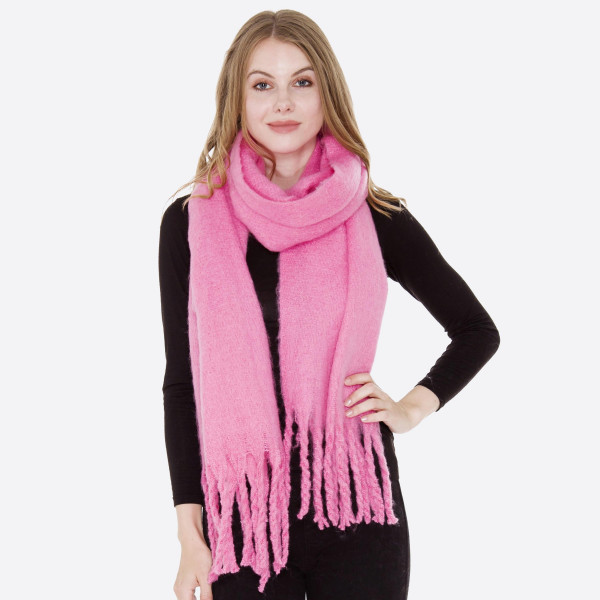 Long solid soft touch scarf. 100% acrylic.