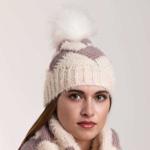 Soft touch beanie with faux fur pompom. 100% acrylic.