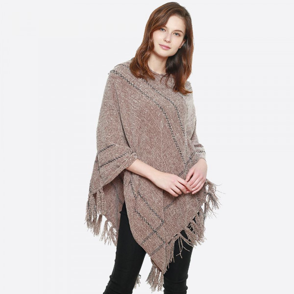 Soft hooded chenille poncho with fringe. 100% polyester.