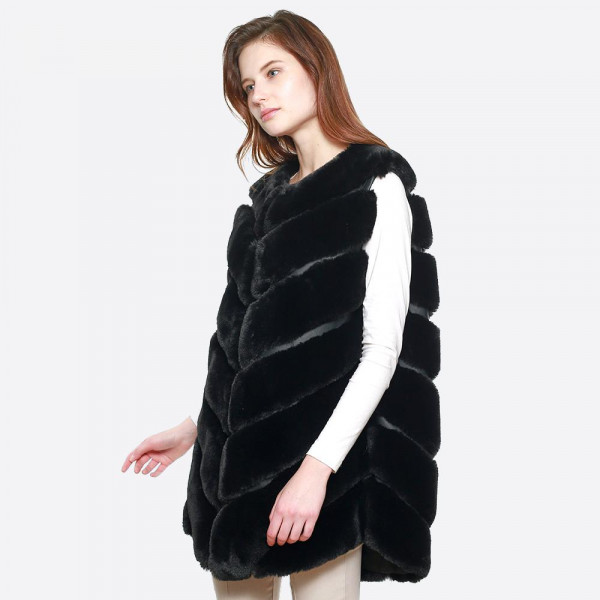 Chevron faux fur long vest. 100% polyester.