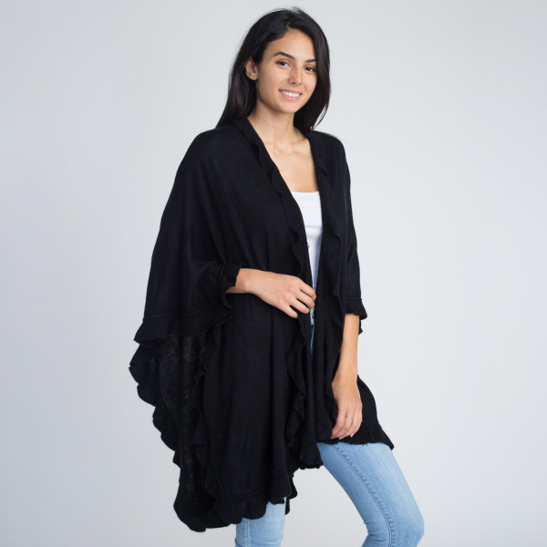 Solid color shawl with ruffle trim. 100% acrylic.   One size fits most.