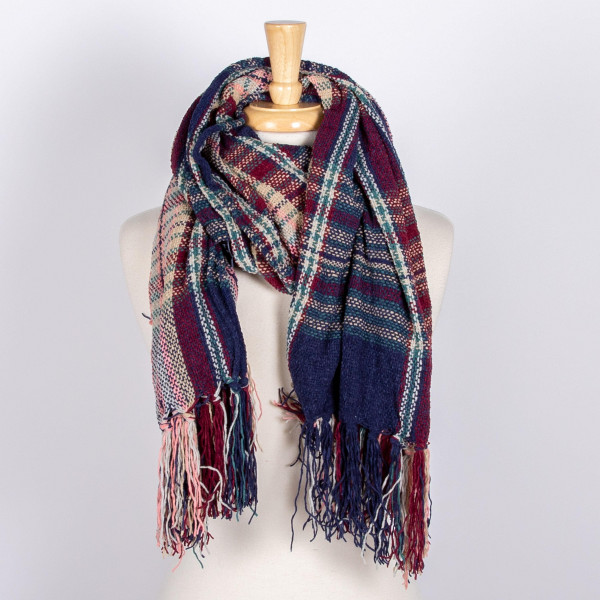 Long plaid scarf with fringe. 100% polyester.
