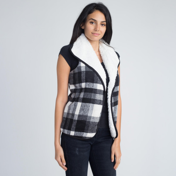 Plaid vest with faux sherpa lining. 100% acrylic.   One size fits most women's size S-L.