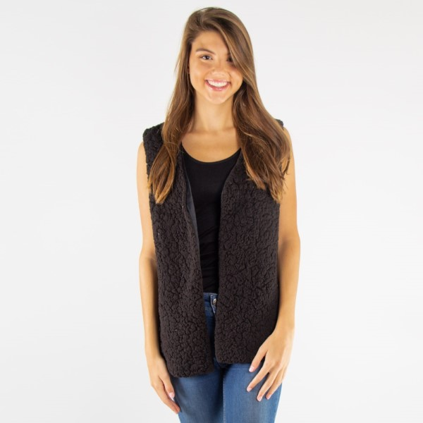 Faux sherpa vest. 100% polyester.   One size fits most.