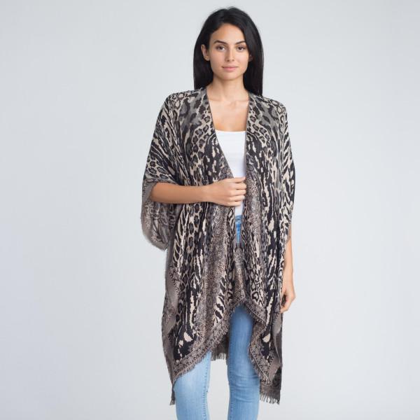 Mixed animal pattern kimono. 100% viscose.   One size fits most.
