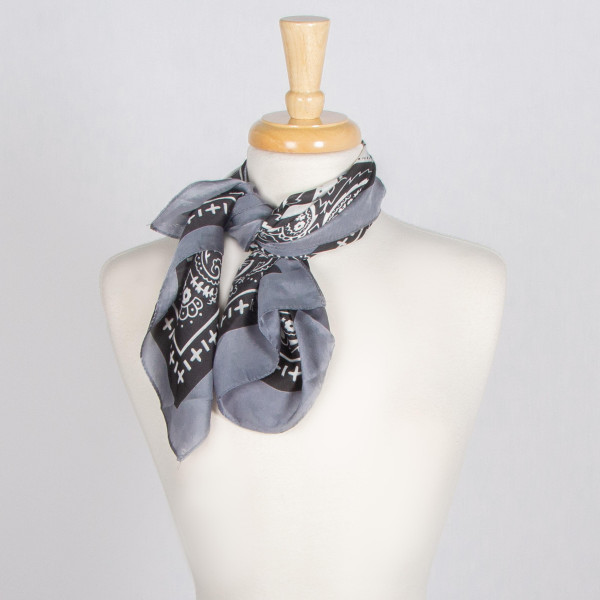 Paisley Silky Bandana with Bordered Trim. 100% polyester L: 27.5 x W: 27.5
