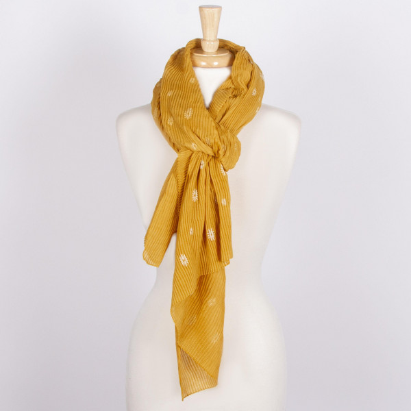 Solid colored scarf with metallic detail. 100% acrylic.