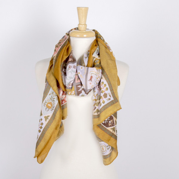 Lightweight floral print scarf. 100% polyester.