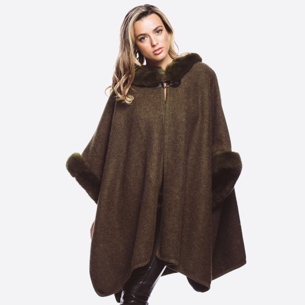 Faux fur trim cardigan with hood. 100% acrylic.   One size fits most.