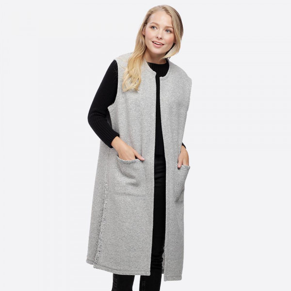 Long line vest with pockets. 100% polyester.   One size fits most.