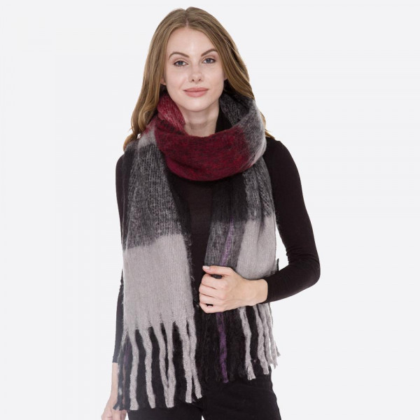 Soft touch check scarf with long fringe. 100% acrylic.