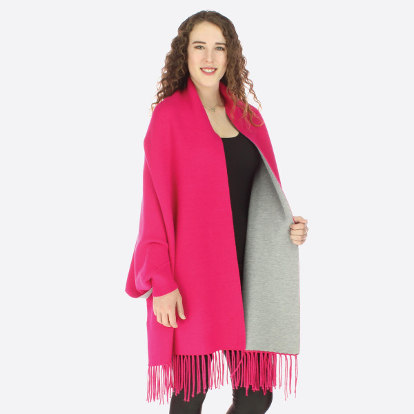 Open front shawl sweater with fringe.   One size fits all.