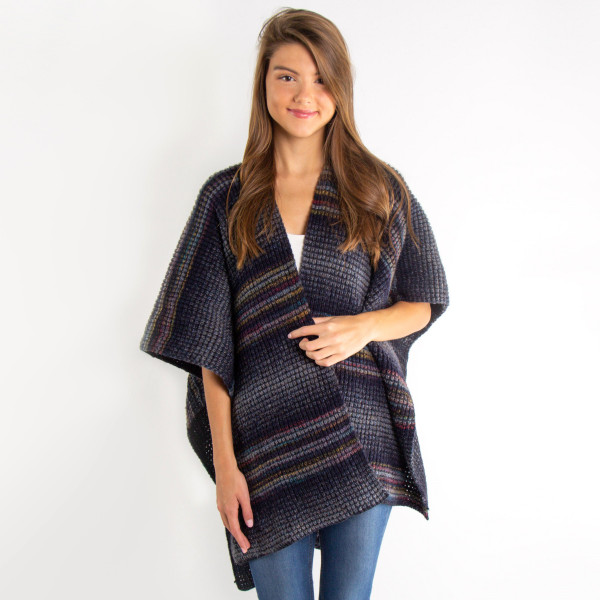 Stay warm with this striped knit kimono. 100% acrylic.   One size fits most.