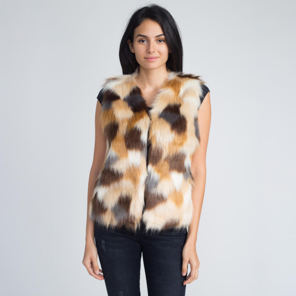 Multi colored faux fur vest. 100% acrylic. 