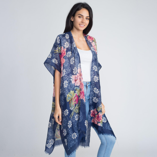 Gorgeous light weight floral print kimono. 100% viscose. One size fits most.
