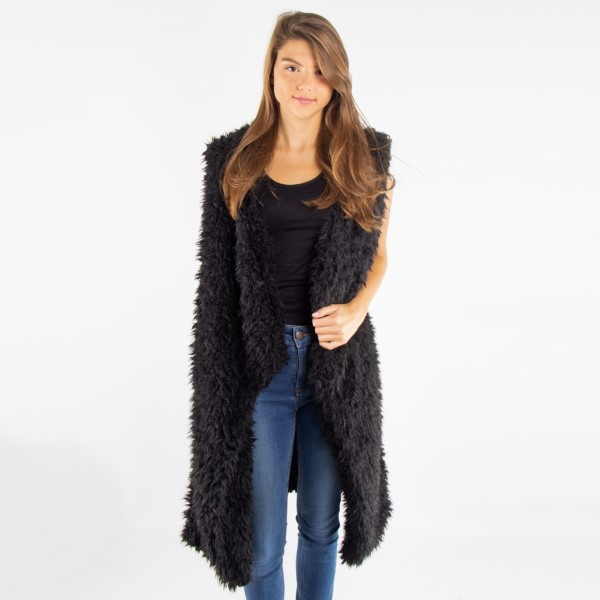 Soft touch faux sherpa vest. 100% acrylic.    One size fits most.