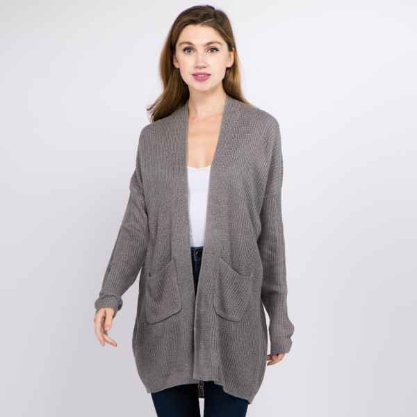 "Solid color thin knit cardigan with front pocket details.  - One size fits most 0-14 - Approximately 29"" in length  - 100% Acrylic"