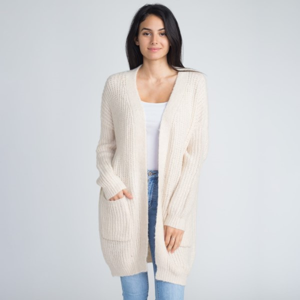 Soft knit cardigan with front pocket detail. 55% acrylic and 45% cotton.   One size fits most sizes S-XL.