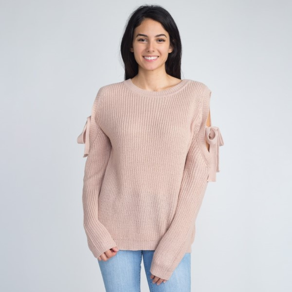Lightweight sweater with open shoulder with tie detail. 55% acrylic and 45% cotton.   One size fits most. (Approximately women's S-L )