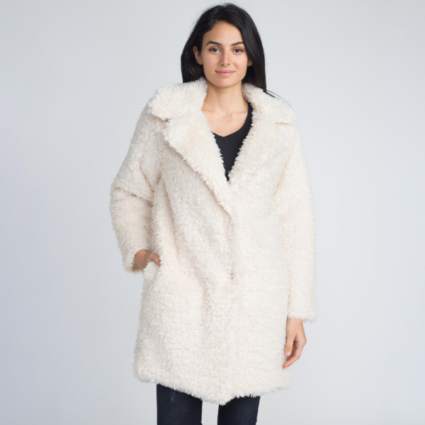 Faux sherpa coat with button closure. 80% acrylic and 20% polyester.   One size fits most.
